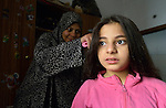 Souad Kasem Issa combs the hair of her daughter Rahaf, 9. She is a Syrian refugee in Amman, Jordan. She and her husband and six children fled the city of Homs as fighting there worsened in 2012. Their home in Syria has since been destroyed by bombing, and they are struggling to survive in Jordan's capital city, where they have received help from International Orthodox Christian Charities, a member of the ACT Alliance.