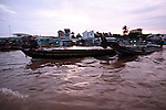 Boats head to market at dawn on the Hau River in the Mekong Delta, south of Can Tho, Vietnam. Sept. 30, 2011.