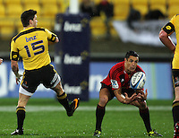 Dan Carter collects Cory Jane's (left) chip kick. Super 15 rugby match - Crusaders v Hurricanes at Westpac Stadium, Wellington, New Zealand on Saturday, 18 June 2011. Photo: Dave Lintott / lintottphoto.co.nz