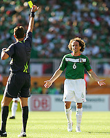 Roberto Rosetti the Italian referee gives a yellow to Gerardo Torrado of Mexico. Mexico defeated Iran 3-1 during a World Cup Group D match at Franken-Stadion, Nuremberg, Germany on Sunday June 11, 2006.