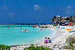 Caribbean, Bahamas, Castaway Cay. Women on beach at Castaway Cay.