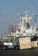 October, 1980. Nagoya, Japan. These ships contain goods and products manufactored in Japan and are internationally exported from Nagoya Harbor.