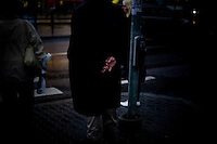 A man holds his hands behind his back as he waits to cross the road in Tallinn, Estonia in Sept. 2009.The young democracy joined the European Union in 2004 and since has been working on getting the euro as its national currency. Estonia has one of the highest per capita incomes in central europe.