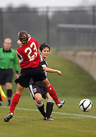 BOYDS, MARYLAND - July 21, 2012:  Diane Weigel (15) of DC United Women passes behind Jamie Clark (23) of the Virginia Beach Piranhas during a W League Eastern Conference Championship semi final match at Maryland Soccerplex, in Boyds, Maryland on July 21. DC United Women won 3-0.