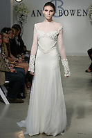 "Model walks runway in a Valor Bridal gown - ivory silk beaded chiffon detail, Chantilly lace, long sleeve net gown, from the Anne Bowen Bridal Spring 2013 ""Coat of Arms"" collection fashion show, during Bridal Fashion Week New York April 2012."