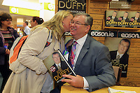 NO FEE PICTURES.15/10/11 Eason, Ireland's leading retailer of books, stationery, magazines and lots more, hosted a book signing by RTE presenter, Joe Duffy. Pictured at Eason,O'Connell Street, Dublin is Joe Duffy who signed copies of his new autobiography Just Joe..Follow Eason on Twitter @easons. Pictured with Joe Duffy is Aedin Johnston, Whitechurch, Co Cork. Pictures:Arthur Carron/Collins