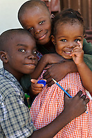Young children at an orphanage supported by EDV, Port-au-Prince, Haiti. EDV is committed to affecting permanent change in disaster-affected communities worldwide. Their role is to facilitate personal connections between volunteers and the survivors of disasters.  The charity is based on a proven model developed by several landmark organisations that have paved the way for citizens to become disaster volunteers. These landmark organisations have shown that supposedly ordinary people working together with the guidance of knowledgeable leaders can make an extraordinary difference in the lives of those affected by disaster..EDV believe that to provide meaningful relief and reconstruction assistance to disaster affected communities they have to do more than reconstruct buildings. They need to understand and address the factors that made a community vulnerable to the disaster in the first place. The charity's work is organised with these factors in mind so that they can affect change that far outlives their presence..EDV believes that survivor motivation is essential to the recovery of any disaster-affected community. Their operations will always be predicated on the idea that survivors may be traumatised, but they are not helpless. With this in mind, EDV encourages host communities to direct their own recovery. EDV believe that this empowerment is essential in helping survivors feel a renewed sense of control over their lives which will, in turn, help overcome the feelings of hopelessness that can follow a disaster and inhibit long term recovery. EDV also believe that social cohesion is of primary importance in any disaster-affected area. No amount of bricks or mortar will bring about sustainable improvement if communities fail to come together or are disrupted by relief efforts. Therefore, their operations will always aim to foster communication and cooperation within and between the communities they serve.