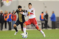 Connor Chinn (25) of the New York Red Bulls is marked by Shea Salinas (11) of the Philadelphia Union. The New York Red Bulls defeated the Philadelphia Union 2-1 during a US Open Cup qualifier at Red Bull Arena in Harrison, NJ, on April 27, 2010.