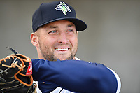 Left fielder Tim Tebow (15) of the Columbia Fireflies prepares to take the field in a game against the Augusta GreenJackets on Opening Day, Thursday, April 6, 2017, at Spirit Communications Park in Columbia, South Carolina. (Tom Priddy/Four Seam Images)