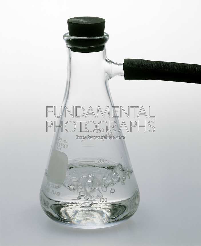 WATER BOILING IN EVACUATED FLASK<br /> Lower Pressure Means A Lower Boiling Point<br /> As the pressure decreases inside the flask the boiling point of the water also decreases and it passes from the liquid phase to the vapor phase.