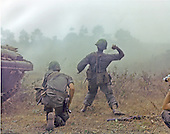 Long Binh, Vietnam - February 23, 1969 -- Members of the First Squadron, 11th Armored Calvary, begin an advance against the enemy's position.  A photographer (far right, partially hidden), films the action..Credit: Kenneth L. Powell - U.S. Army via CNP