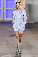 Arizona Muse walks the runway in a blue/white striped silk field jacket, blue/white striped cotton button-down tank top, and blue/white cotton pleated shorts, by Tommy Hilfiger for the Tommy Hilfiger Spring 2012 Pop Prep Collection, during Mercedes-Benz Fashion Week Spring 2012.
