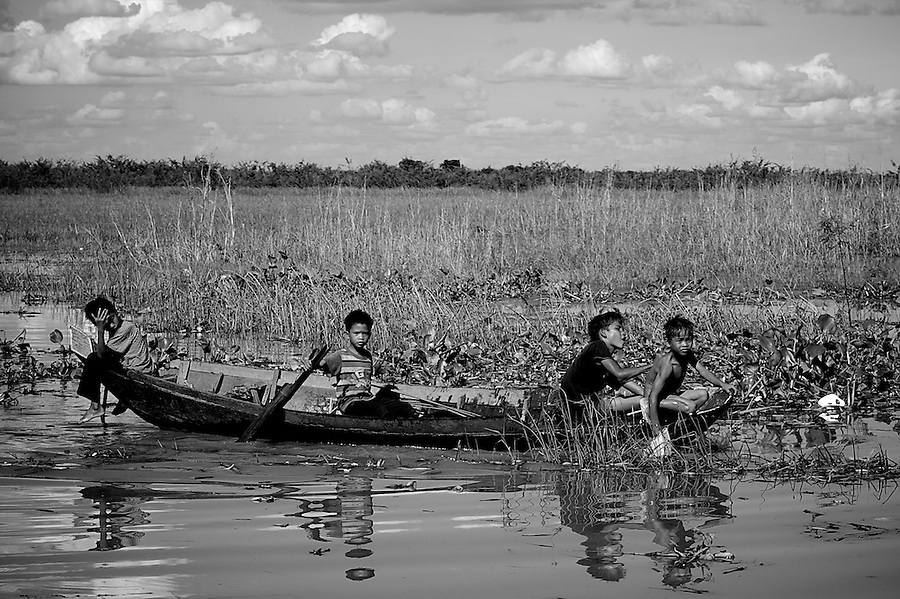 Tonle Sap, The Great Lake is Asia's largest freshwater basin seated in central Cambodia. It's shores and waters are home to many peoples who take life and living from the waters. Their villages migrate with the swells and returns brought by the seasonal rains.