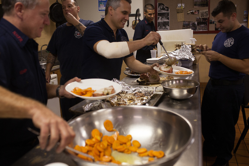 From left; fire fighter Greg Kemp, FF John Palombini, Capt. Joe McLean, probationary FF Andres Godoy and FF Kimil Mizinsky serve dinner at the 16th Street Fire House of the North Hudson Regional Fire and Rescue in Union City, NJ on November 07, 2013. Many vets say after the military they're still looking for a career with a sense of public service. Some vets have found that at the North Hudson Regional Fire and Rescue in New Jersey.