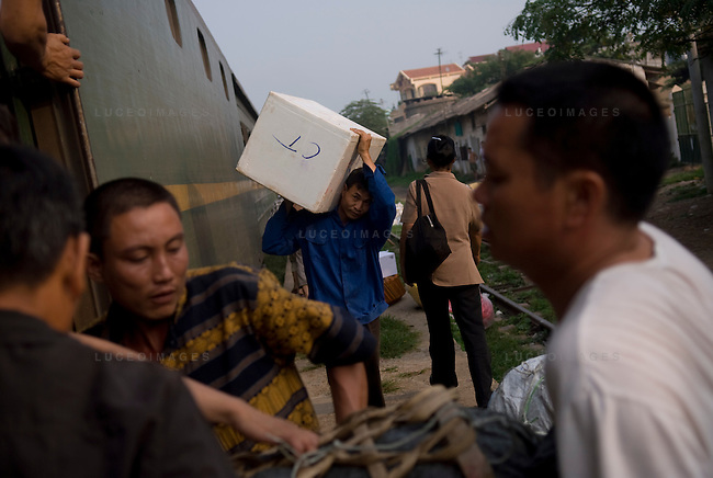 Workers unload supplies from the train heading from Hanoi to Sapa, Vietnam.