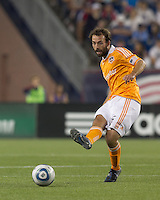 Houston Dynamo midfielder Adam Moffat (16) passes the ball. In a Major League Soccer (MLS) match, the New England Revolution tied Houston Dynamo, 1-1, at Gillette Stadium on August 17, 2011.