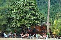 Kampung Air Batang, Pulau Tioman Island, Malaysia, October 2010. Nazri 1, located at the beach of sunset corner, is one of the first tourism accommodation on the island. Tioman Island is a tropical island paradise off the east coast of Malaysia. Independent tourists come here to relax on the palm fringed beaches, for diving and snorkeling or for trekking through the rainforest. Photo by Frits Meyst/Adventure4ever.com