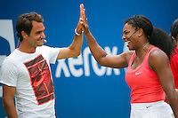 Tennis players Roger Federer, ( L), and Serena Williams shakes hands while they attend the Arthur ASHE kids day at the US Open 2015 in New York. 08.29.2015.  Eduardo MunozAlvarez/VIEWpress.