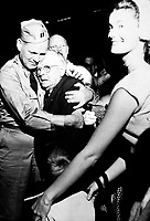 Repatriated POW Capt. Frederick Smith is greeted by his father on his arrival at Fort Mason, Calif., on board the USNS Marine Phoenix.  September 14, 1953.  Herb Weiss. (Army)<br /> NARA FILE #:  111-SC-431160<br /> WAR &amp; CONFLICT BOOK #:  1521