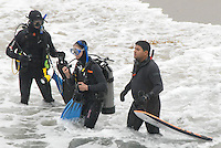 Scuba divers from Eco Dive Center, remove liter from the Pacific Ocean during Heal the Bay's Coastal Cleanup Day at Santa Monica beach on Saturday, September 17, 2011.
