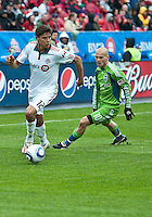 25 April 2010: Toronto FC defender Adrian Cann #12 takes the ball up field as Seattle Sounders midfielder Freddie Ljungberg #10 gives chase during a game between the Seattle Sounders and Toronto FC at BMO Field in Toronto..Toronto FC won 2-0....