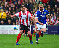 Lincoln City's Matt Rhead shields the ball from Macclesfield Town's Kingsley James<br /> <br /> Photographer Andrew Vaughan/CameraSport<br /> <br /> Vanarama National League - Lincoln City v Macclesfield Town - Saturday 22nd April 2017 - Sincil Bank - Lincoln<br /> <br /> World Copyright &copy; 2017 CameraSport. All rights reserved. 43 Linden Ave. Countesthorpe. Leicester. England. LE8 5PG - Tel: +44 (0) 116 277 4147 - admin@camerasport.com - www.camerasport.com