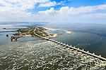 Nederland, Zeeland, Oosterschelde, 09-05-2013; Oosterschelde Stormvloedkering tussen Schouwen en Noord-Beveland met inkomend tij. Sluitgat Schaar, werkeiland Neeltje Jans (links), foto richting Noordzee, Walcheren in de achtergrond..Storm surge barrier in Oosterschelde (East Scheldt), between Islands of Schouwen-Duiveland and Noord-Beveland; North Sea on the right side of the barrier. Under normal circumstances the barrier is open to allow for the tide to enter and exit. In case of high tides in combination with storm, the slides are closed..luchtfoto (toeslag op standard tarieven).aerial photo (additional fee required).copyright foto/photo Siebe Swart