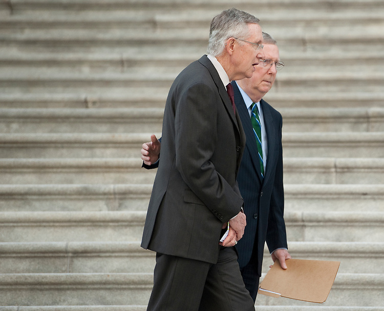 UNITED STATES - SEPTEMBER 12: Senate Minority Leader Mitch McConnell, R-Ky., and Senate Majority Leader Harry Reid, D-Nev., talk as both houses of Congress gather on the East Front steps of the Capitol to hold a 9/11 Remembrance Ceremony on Monday, Sept. 12, 2011. (Photo By Bill Clark/Roll Call)