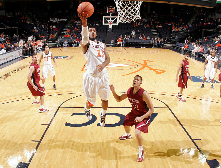 Nov 6, 2010; Charlottesville, VA, USA; Virginia Cavaliers Mike Scott (23) shoots the ball in front of Roanoke College Joey Leech (42) Saturday afternoon in exhibition action at John Paul Jones Arena. The Virginia men's basketball team recorded an 82-50 victory over Roanoke College.