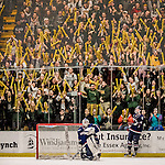 20 January 2017: University of Vermont fans celebrate a Catamount goal as University of Connecticut Huskies Goaltender Adam Huska, a Freshman from Zvolen, Slovakia, can only look out from the net in the first period at Gutterson Fieldhouse in Burlington, Vermont. The Catamounts held onto their lead throughout the game to defeat the Huskies 5-4 in Hockey East play. Mandatory Credit: Ed Wolfstein Photo *** RAW (NEF) Image File Available ***
