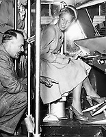 Interior Shot of Adeline Svendsen Operating Foot Controls of PCC Streetcar, Taken for Trolley Topics Magazine
