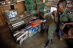 A VIDEOCLUB, FULL OF FORGED VCDS AND VIDEOS / MARS 2006, NATITINGOU, BENIN / ANTOINE DOYEN