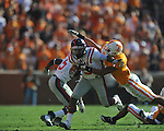 Ole Miss running back Jeff Scott (3) stiff arms Tennessee defensive back Janzen Jackson (15) in a college football game at Neyland Stadium in Knoxville, Tenn. on Saturday, November 13, 2010. Tennessee won 52-14.