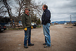 Former Montana Governor Brian Schweitzer, right, asks Jay Krieg, left, of Eagle Post and Pole about the price of fence poles in Hall, Montana, May 7, 2014.<br /> CREDIT: Max Whittaker/Prime for The Wall Street Journal<br /> BRIAN