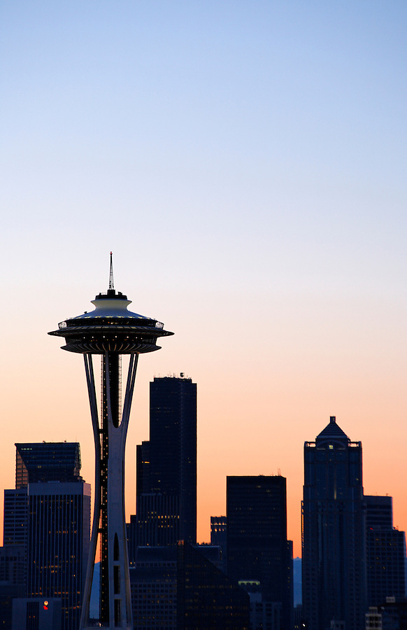 The Seattle Space Needle and Seattle skyline are silhouetted against a morning sky, Washington, USA