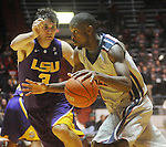 "Ole Miss forward Terrance Henry (1) is defended by Louisiana State's Garrett Green (3) at the C.M. ""Tad"" Smith Coliseum in Oxford, Miss. on Wednesday, February 9, 2011. Ole Miss won 66-60 and is now 4-5 in the Southeastern Conference."