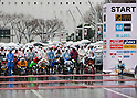 Feb. 28, 2010 - Tokyo, Japan - Wheelchair competitors prepare for the race at the starting point of the 2010 Tokyo Marathon. Despite the cold and rain, more than 30,000 athletes participated in the event.