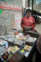 A man buying pirated CD from a street stall in  Kolkata, West Bengal,  India  7/18/2007.  Arindam Mukherjee/Landov