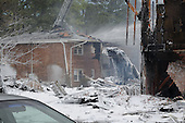 Firefighting foam covers the scene of a crash of an F/A-18D Hornet, assigned to Strike Fighter Squadron (VFA) 106, in Virginia Beach, Virginia on April 6, 2012. Initial reports indicate that at approximately 12:05 p.m., the jet crashed just after takeoff at an apartment complex in Virginia Beach. Both air crew safely ejected from the aircraft and are being treated at a local hospital. .Mandatory Credit: Antonio P. Turretto Ramos / US Navy via CNP
