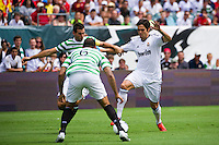 Kaka (8) of Real Madrid is marked by Joe Ledley (16) and Kelvin Wilson (6) of Celtic F. C.. Real Madrid defeated Celtic F. C. 2-0 during a 2012 Herbalife World Football Challenge match at Lincoln Financial Field in Philadelphia, PA, on August 11, 2012.