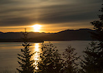 Idaho, North, Coolin. A hazy sunset over Priest Lake on the first day of summer, 2014.