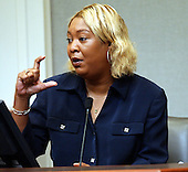 Charlene Anderson, of Baton Rouge,  Louisiana, the first cousin of John Allen Muhammad, demonstrates the size of a bullet that sniper suspect John Allen Muhammad asked her to secure during her testimony in courtroom 10 at the Virginia Beach Circuit Court in Virginia Beach, Virginia on October 27, 2003.<br /> Credit: Davis Turner - Pool via CNP