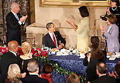 Washington, DC - January 20, 2009 -- United States President Barack Obama, center, gets a standing ovation including, from left to right,  from Vice-President Joe Biden, first lady Michelle Obama, Speaker of the House Nancy Pelosi and UNited States Senator Dianne Feinstein, (Democrat of California), top right, at the end of the luncheon at Statuary Hall in the U.S. Capitol  in Washington  Tuesday, January 20, 2009. .Credit: Lawrence Jackson - Pool via CNP