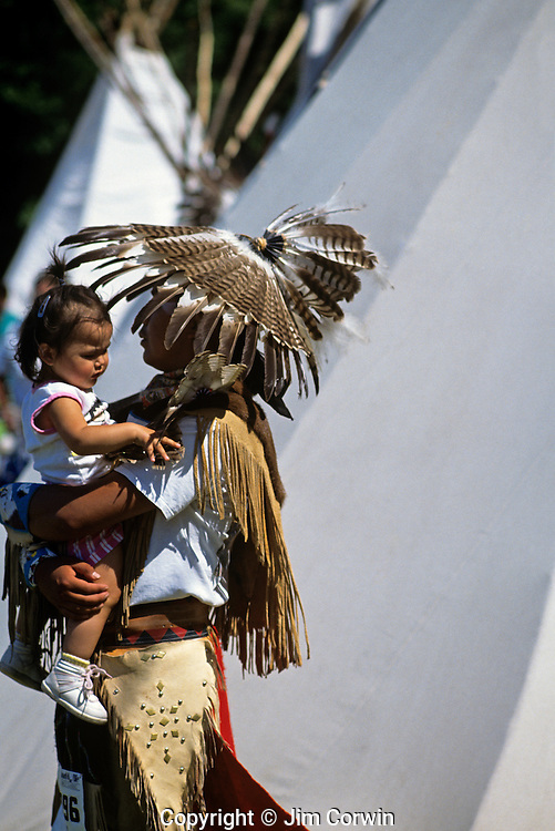 Day break Cultural Center pow-wow performer holding child
