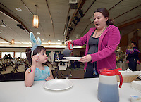 NWA Democrat-Gazette/BEN GOFF -- 03/21/15 Sarah Paxton and daughter Bobbi Paxton, 4, of Bentonville help themselves to pancakes during the pancake breakfast and Easter egg hunt at First United Methodist Church of Bella Vista on Saturday, Mar. 21, 2015.