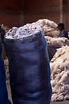 Bags of alpaca wool wait to be cleaned in an alpaca wool factory in El Alto,Bolivia.