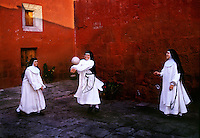 Novices play ball in the court yard during a break in their silence from the strict cloistered life in Santa Catalina Convent in Peru. Seven times during the day the young girls go to their chapel for chorus and pray, but once a day they play or sing in the garden. Among the 30 women who live in the convent are five novicias who study for five years to become a nun. The youngest is 15, the oldest nun is 98. <br />