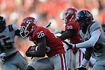 Georgia cornerback Malcolm Mitchell (26) is chased by Ole Miss defensive back Mike Hilton (28) at Sanford Stadium in Athens, Ga. on Saturday, November 3, 2012.