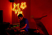 The inhouse DJ spins at The Zoo, a funky nightclub located in the south of New Delhi, India. Photograph: Sanjit Das/Panos