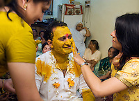 Suketu Soni, the groom, gets covered in traditional turmeric in a Hindu wedding blessing ceremony in the state of Gujarat, in northwest India. Traditionally, Indian weddings are elaborate celebrations filled with rituals and customs dating back thousands of years. The marriage of Suketu Soni and Divya Agarwal was a modern love marriage, and not an arranged marriage.